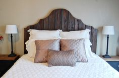 Reclaimed headboard out of old fence boards...  I would just attach a metal bed frame, add a bed skirt and call it good!