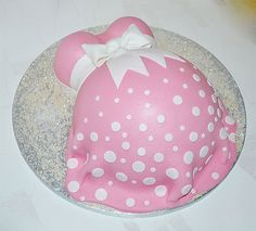 Pretty Pink Baby Bump / Pregnant Belly Cake with handmade fondant bow.