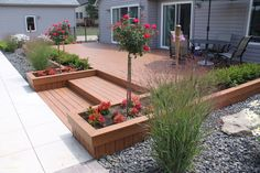 Deck planter boxes with tree form rose, boxwood hedge annuals and ornamental grass. Designed and installed in Howell Michigan by Frank Spiker of All Natural Landscapes. Patio Plan, Backyard Patio, Backyard Landscaping, Landscaping Ideas, Patio Deck Designs, Patio Design, Garden Design, Patio Ideas, Back Yard Deck Ideas