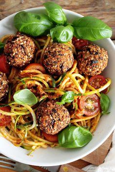 Crispy vegan Black Bean and Quinoa Balls with spiralized zucchini and a delicious sun-dried tomato sauce. Gluten-free + oil-free