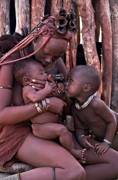"Africa | ""Tenderness"".  Himba mother with her children.  Namibia 
