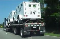 "Armored UN trucks were seen leaving Alabama and entering Georgia last year. Is there any reason there should be UN truck on American soil?  With unmarked flat-beds painted in ""UN blue"", the trucks have openings for M231 port firing weapons.  As the armored vehicles appear to be new, one wonders if they were built here. There doesn't seem to be information about the United States manufacturing trucks for the UN readily available online.  This video was shot last year. If anyone has amore ..."