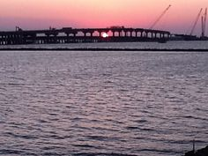 Grand Isle sunset with the new bridge under construction.