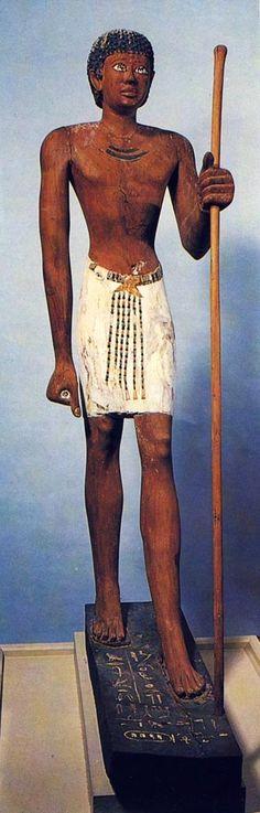 *EGYPT ~ Niankhpepi, - black - wood sculpture. Dynasty VI. Museum of Cairo. Picture in j. p. COR-TEGGIANI, L' Egypte des pharaons au Musée du Caire, Paris, 1986, p. 60.