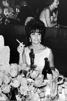 20 vintage photos from Old Hollywood's Oscars, Golden Globes and more awards shows: Elizabeth Taylor at the 1961 Academy Awards