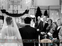 David watches as his bride Yao walks down the aisle to marry him. Photo by: FRPhoto