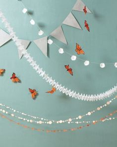 """Travel-Friendly Decor   Rolled up, these garlands fit into the corner of your carry-on. Unfurled, they can elevate any ceremony or reception spot.         From top: Preppy BHLDN parchment pennants ($26 for 5 strands). Pearl River butterfly garlands ($13.50 each). 10,000 Villages """"Showers of Flowers"""" ($14 each). Luna Bazaar """"Little Stars"""" ($3.50 for 2 strands). Kristina Marie confetti garlands (from $24 for 10 feet)."""