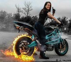 motorcycle girl do a burnout with flames