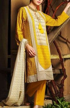 Buy Mustard Embroidered Cotton Lawn Dress by Khaadi Lawn Collection 2015.
