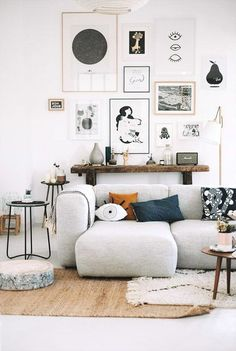 Bright white Scandinavian living room with modern interior and wall art.