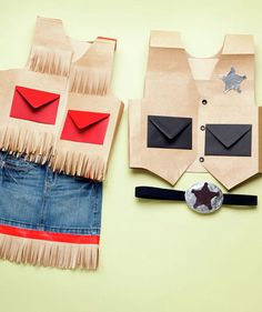 How to make cowgirl and sheriff costumes.  The vest is made out of paper bags and envelopes!  For Western Night.