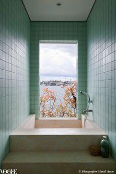 A deep Japanese tub with Sydney harbour views.    Photograph by Marcel Aucar.