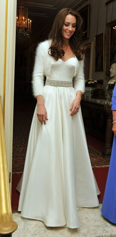 My, she does have class.  Kate Middleton's white luxury evening gown with evening sweater...as seen at http://au.ibtimes.com/articles/258870/20111201/kate-middleton-orders-new-gowns-alexander-mcqueen.htm