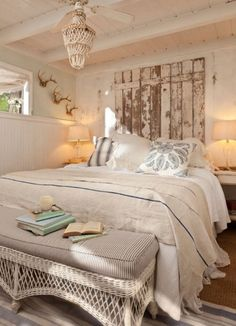 Cottage Bedroom-bed in front of window..get old metal bed with barn sliders for windows.
