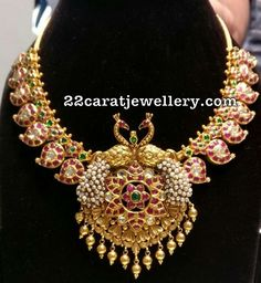 22 carat gold mango necklace with elaborated trendy pendant. Rubies, emeralds and white polki kundan stones adorned mango necklace with antique finish peacock floral pendant