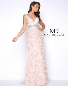 Porcelain, sleeveless, deep V-neck, beaded bodice with trimmed neck and waistline. This A-line prom dress includes a hand stitched feather skirt and open back.