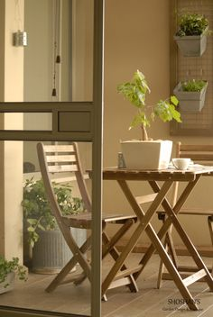 Small balcony, plantpots on the wall
