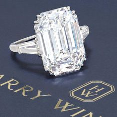 Diamond Ring from Harry Winston from circa 1953. Set with a 12.55 carats step-cut diamond and flanked by two tapered baguette diamonds. GIA report, numbered 6204649642, dated 20 March 2020, D colour, Internally Flawless clarity. Diamond type classification report, type IIa diamond. PlatinumSigned WINSTON for Harry Winston. Size 6½. Estimate: HK$6,800,000 - 8,800,000. #auction #jewelleryauction #jewelryauction #phillipsjewels #phillipsauction Yellow Diamond Rings, Diamond Earing, Diamond Cuts, Harry Winston Engagement Rings, Engagement Ring Cuts, Bangles Making, Jewels, Expensive Diamond Rings, Editor