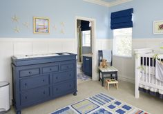 I like the limited use of navy blue and how it's mostly in the furniture, instead of on the walls.