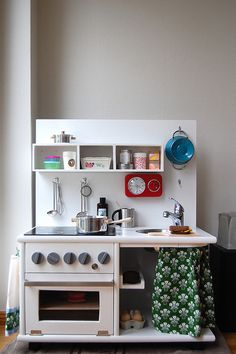 This DIY kitchen makes me smile. and wish I had a real one half as nice. haha