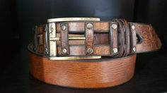 Brown Leather Belt, Designer Belt, Mens Belt, Buckle Belt, Steampunk Belt, handmade for Men  The belt is made from full grain leather The Buckle :rectangle shaped in antique bronze color Color : vintage brown If you want this belt with a different buckle please convo me   Length : custom made to your need   Measurement: Width : 1.73 inch \ 4.4 cm Thickness:3.5 mm Length will be custom made for you - Dont forget to leave your waist size! *standard I make five holes ,on request I can add more…