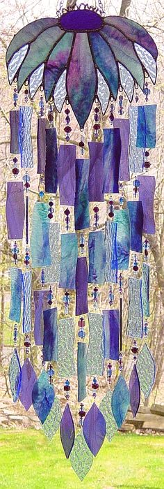 love this idea of stained glass piece combined with wind chime pieces... so colorful and dramatic!!