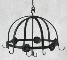 Jason Getzan - wrought iron hanging pot rack with nine hooks, flower design. bought on ebay in 2013.