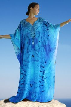Precious silk Kaftan with spreading of feathers in a mixed blue embellished with crystal – Angel blue