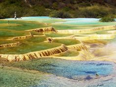 Huanglong, China ~ This place is known for its colorful pools formed by calcite deposits.