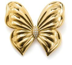 VAN CLEEF AND ARPELS (CO.) A diamond brooch, by Van Cleef  Arpels  Modelled as a stylised butterfly, the body pavé-set with diamonds, length 6 cm, signed 'V.C.A.', numbered B1380 A19.
