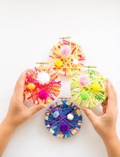 DIY String Art Mini Embroidery Hoop Ornaments. These make easy and colorful ornaments kids can make.