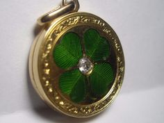 14K gold four leaf clover locket pendant diamond green enamel ornate detail luck