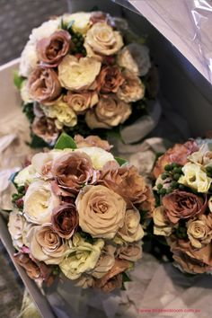 Antique champagne `Sahara` roses, latte `Julia` roses, white David Austin roses, ivory lisianthus, and berzillea berry