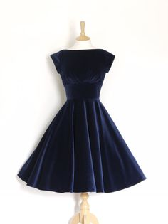 This show-stopping dress is made from a midnight blue velvet - perfect for turning heads at any formal occasion! The bodice is fitted and has a