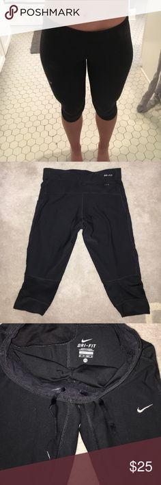 Nike Leggings Very comfy short black Nike leggings. Lightly worn but great condition! Includes back pocket and adjustable strings. Nike Pants Leggings