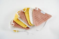Crochet flags, yellow, old pink and white.