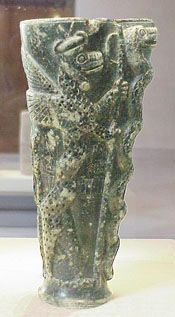 """Gudea Vase--""""On exhibit in the Louvre is a green libation vase, excavated from the ancient Mesopotamian city of Lagash.  The inscription on it, from King Gudea of Lagash circa 2025 BC, is a dedication to Ningizzida.  Also on the vase is an image of two entwined snakes on a rod.  Some have dated the vase as far back as 4000 B.C. The rod is most likely to be Axis Mundi, the world tree, Yggdrasil, the tree of life.  Ningizzida, a fertility god, was also known as 'Lord of the Tree of Life...."""""""