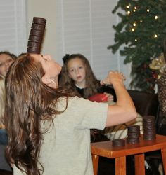 7 MINUTE-TO-WIN-IT Games~ (Pictured- Stack more Ding Dongs on your forehead than your oponent before the 1 minute timer goes off & you win!) for parties, church activities, showers, holiday, etc.