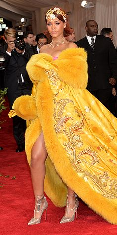 The Most Jaw-Dropping Dresses at the 2015 Met Gala   RIHANNA   being the night's biggest risk-taker in a bright-yellow ballgown by Chinese couture designer Guo Pei featuring a dramatic train-cape and opulent fur detailing, plus Christian Louboutin heels and Cartier jewels.