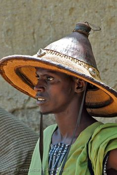 ... , that conical hat is typical of West Africans like the Fulani. Description…