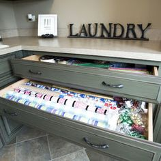 wide drawers in laundry room for wrapping paper