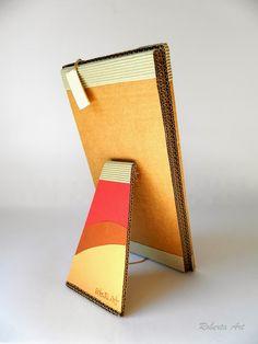 Specchio realizzato con carta e cartone riciclato