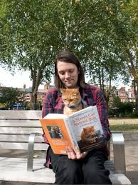 Great Photo of James Bowen and Bob the street cat reading their own story - It's a great story for all cat lovers! #Cats #Books