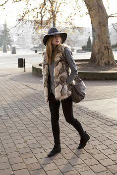 Winter outfit: grey wool hat, fur vest, grey sweater, black skinny pants, black booties, brown bag