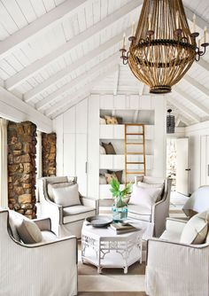 Bold, large-scale prints feel particularly loud in a white space. Opt for understateddesigns, like the brown stripes on these club chairs, to add interest. Brown cording on the chairs and pillows provides another delicate touch.