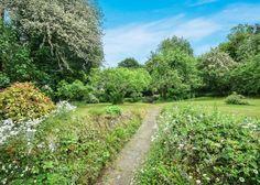 Pretty cottage garden with Tudor cottage in Dartington