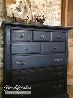Painted with a mixture of 3 parts Napoleonic Blue and 1 part Graphite Chalk Paint®. Sealed with Annie Sloan Black Wax.