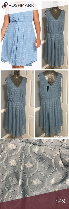 """NWT Torrid Blue Chiffon V-Neck Tank Dress So Pretty and Flowing with a raised print on chiffon fabric, and little give with the gathered waist, the perfect dress for a wedding or dinner date 💕 NWT its 100% Polyester and is a Size 16. (model in cover is 5'10) It measures about 21.5"""" across chest laying flat and about 41"""" in length...bundle to save more plus ⚡️📦📫😁💕 torrid Dresses"""
