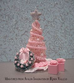 tiny miniature trees | ... tree in in Pink with two tiny Gifts and Wreath, and tree skirt. via