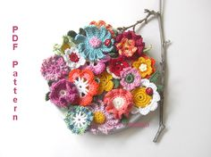 This would make a pretty, unconventional  bouquet for the crafty bride :)  Crochet Flowers 10 Flowers 3 Leaves - via @Craftsy